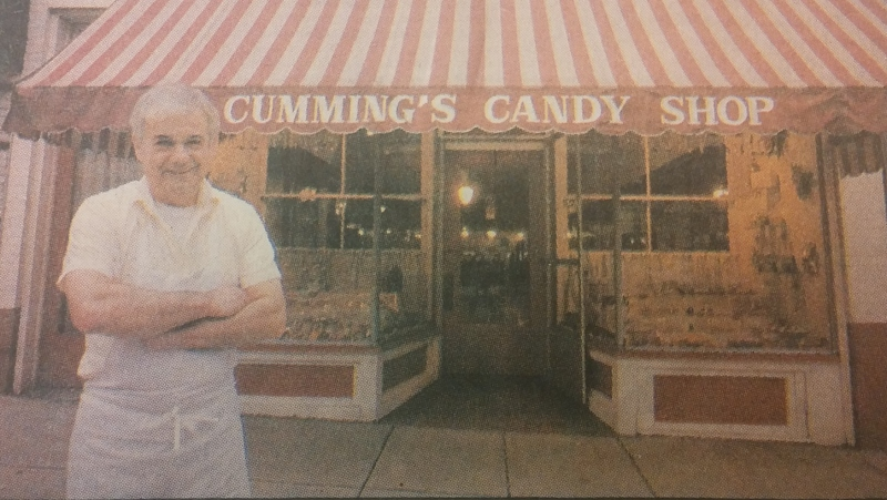Tom Cummings outside of his store